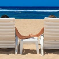 Couple on beach in chairs SM 205x205 Planning your Honeymoon