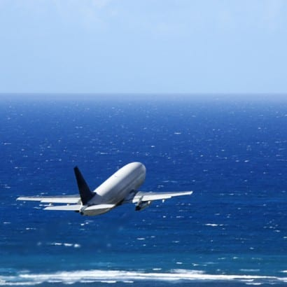 "<img scr="" Airplane over ocean.jpg"" alt=""Take a family vacation by air, Omaha, Enchanted Honeymoons"">"